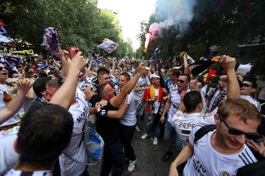 Real Madrid fans drank, danced and cheered on Calle de Marceliano Santa Maria near the Bernabeu Stadium in anticipation of their teamÕs EUFA Championship.